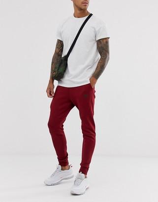 Nike Tech Fleece joggers in burgundy-Red