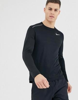 Nike Running miler long sleeve top in black