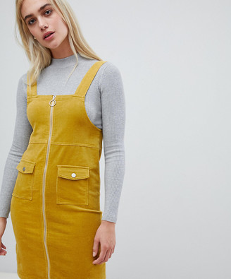 Pieces zip front pinafore mini dress in yellow