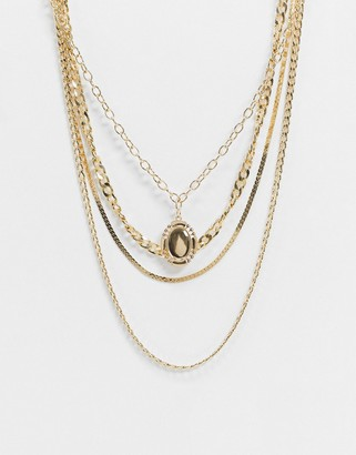 Pieces multi row necklace with drop pendant in gold