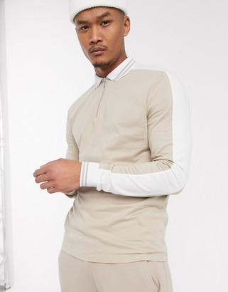 ASOS DESIGN organic long sleeve polo shirt with zip neck and contrast shoulder panels in beige
