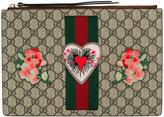Gucci embroidered GG Supreme clutch bag
