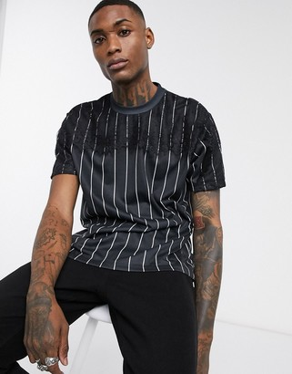 Asos DESIGN oversized vertical stripe t-shirt with lace sleeve detail