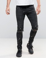 Asos Super Skinny Jeans With Abrasions And Knee Zip Rips In Black Coating