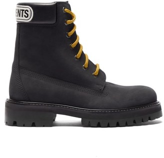 Vetements Logo-debossed Nubuck Ankle Boots - Womens - Black