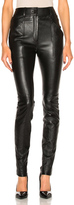 Saint Laurent Stretch Leather Leggings in Black.