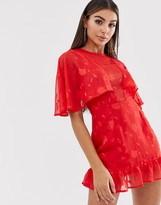 Lasula plunge cape mini dress with frill hem in red lace overlay