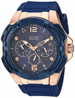 GUESS Oversized Iconic Rose-Gold-Tone Blue Stain Resistant Silicone Watch with Day Date + 24 Hour Military/Int'l Time. Color: Iconic Blue (Model: U1254G3)
