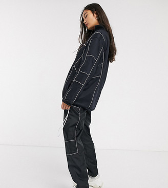 Ellesse wide leg tracksuit joggers with reflective piping co-ord