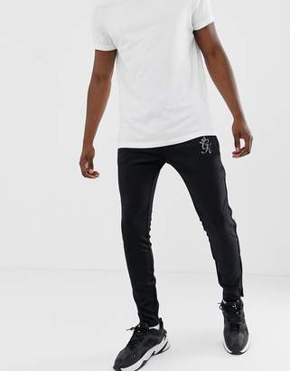 Gym King Freeman reflective poly tracksuit bottoms in black