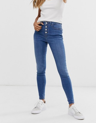 B.young skinny jeans with button fly