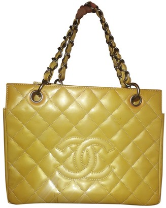 Chanel Yellow Patent leather Handbags