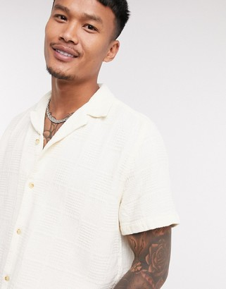 ASOS DESIGN textured short sleeve shirt with revere collar in off white