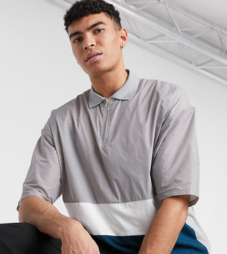 Asos DESIGN Tall oversized polo shirt with zip neck and gray woven color block
