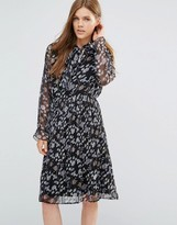 Yumi Long Sleeve Pleated Dress With Frill Sleeve