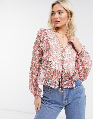 Neon Rose blouse with ruffle front and tie back detail in ditsy floral