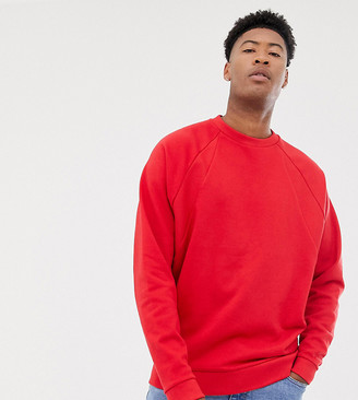 Asos DESIGN Tall oversized sweatshirt with rib detail in red