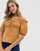 Asos Design DESIGN off shoulder top with lace up detail in textured cotton
