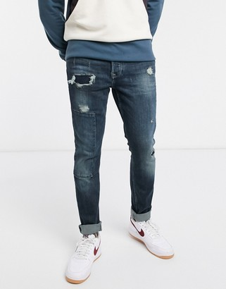 Topman skinny jeans with repair patches in mid blue