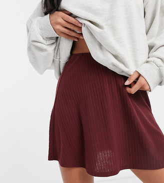 ASOS DESIGN Petite flippy mini skirt in rib in wine