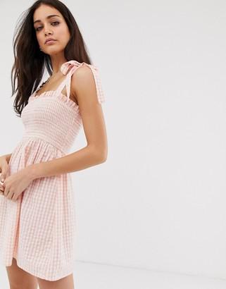 Stradivarius STR tie strap dress in pink gingham