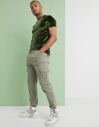 Asos DESIGN tapered cargo trousers with toggles in light green