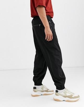 Asos tapered joggers in black nylon