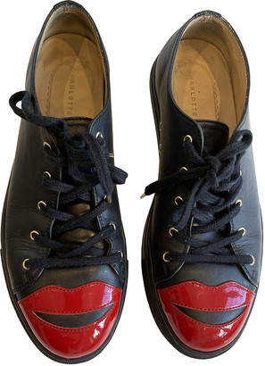 Charlotte Olympia Black Leather Trainers