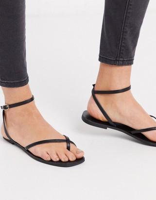 Asos Design DESIGN Farnborough minimal toe loop flat sandals in black