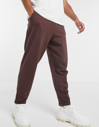 ASOS DESIGN oversized joggers with rolled cuffs in brown