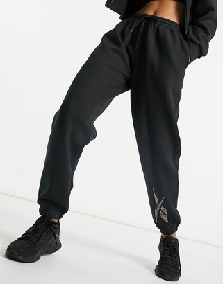 Reebok Training trackies in black with leopard logo