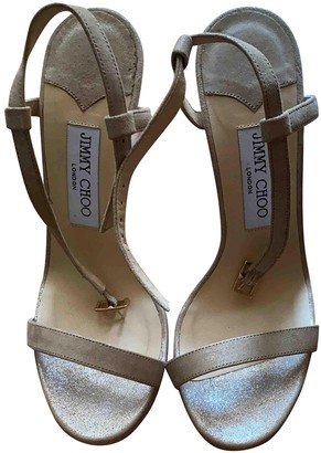 Jimmy Choo Gold Suede Sandals