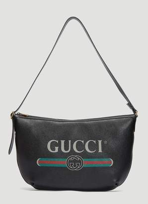 Gucci Logo Print Half-Moon Hobo Bag in Black