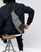 Asos DESIGN Cross Body Flight Bag In Khaki With Mesh Pocket