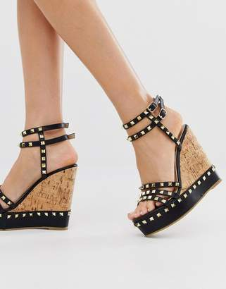 Truffle Collection studded wedge in black