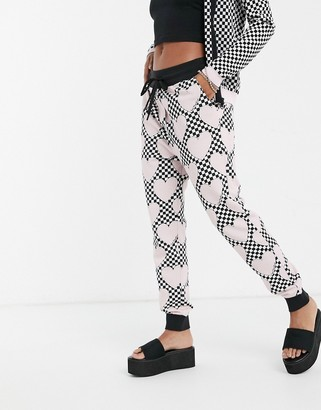 Love Moschino allover heart print joggers in pink multi