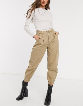 Bershka slouchy jean with cuff detail in camel