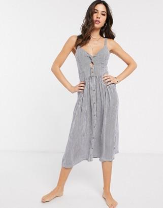 Accessorize beach dress in blue stripe
