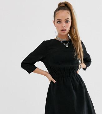 ASOS DESIGN Petite casual elasticated mini dress in grid texture in black