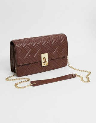 ASOS DESIGN multi way shoulder quilted cross body bag with hardware detail in brown