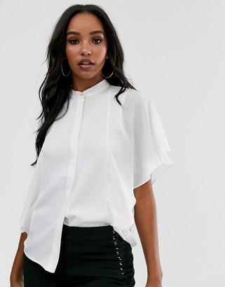 ASOS DESIGN sleeveless soft shirt with ruffle detail