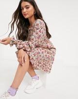 New Look shirred cuff mini dress in cream ditsy floral print