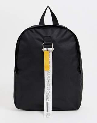 Asos Design DESIGN backpack in black with slogan strap