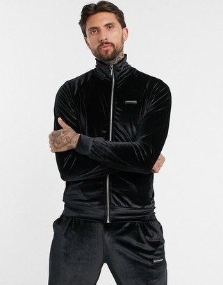 Good For Nothing velour track top with raised rubber branding in black