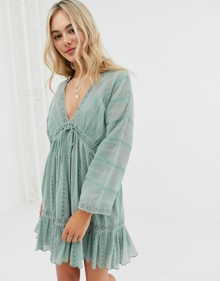 ASOS DESIGN lace insert mini smock dress with lace up detail