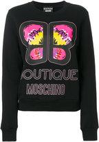 Moschino logo print sweatshirt - women - Cotton - 36