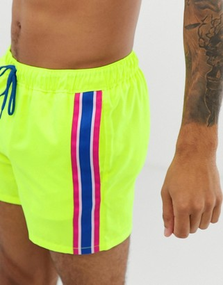 Asos Design DESIGN swim shorts in neon yellow with side stripe in short length