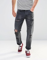 Asos Relaxed Jeans With Rips In Washed Black