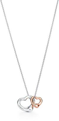 Tiffany & Co. Elsa Peretti Open Heart pendant in silver and 18k rose gold, extra mini