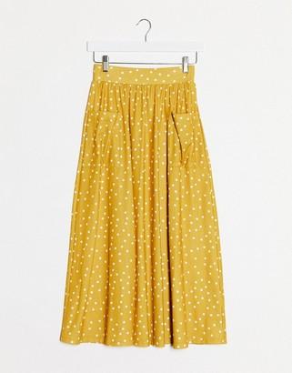 Asos DESIGN midi skirt with pockets in mustard spot print